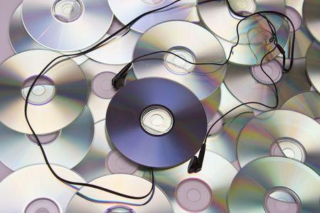 megabytes: Grey and black earphones and compact disc Stock Photo