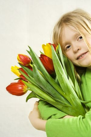 Little blond girl and bunch of colorful tulips Stock Photo - 3177814