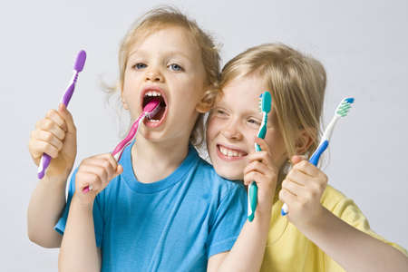 yellow teeth: Little girl wearing colorful t-shirts brushing teeth