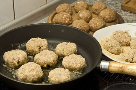Round burgers made of pork minced meat photo