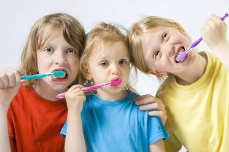 Little girl wearing colorful t-shirts brushing teeth Stock Photo - 3289828