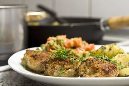 Pork burgers with potatoes, carrot and green peas photo