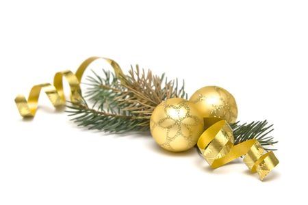 Golden  bulbs and spruce twigs on a white photo