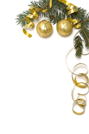 Golden  bulbs and spruce twigs on a white Stock Photo