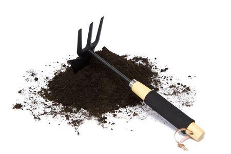 Springtime. Gardening tools and soil on a white. photo