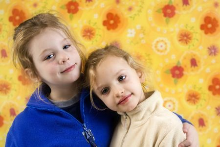 Portrait of children on a yellow floral backgound Stock Photo - 6663203
