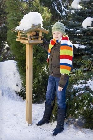 feeder: Wooden feeder for birds in snowy garden