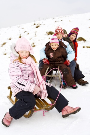 Children playing on the snow photo