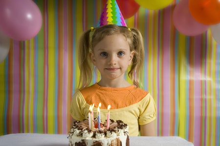 baloons: Happy children with birthday cake on a striped background