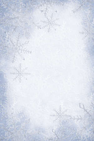 snowflake border: Blue and white snowflakes on a blue and white background Stock Photo