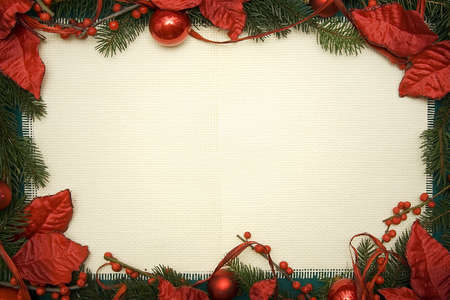 christmas frame: Christmas ornament made of green spruce and red adornment