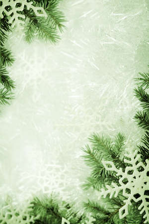 Christmas background made of spruce branch and snowflakes photo