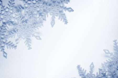 Blue and white snowflakes on a blue and white background Stock Photo - 16054643