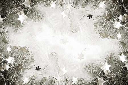Silver sparkling stars on a white glistening background photo