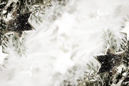 Silver sparkling stars on a white glistening background Stock Photo - 16134219