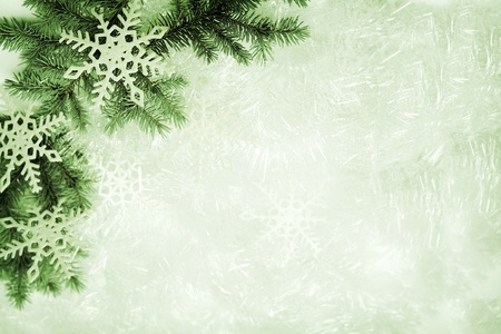 Christmas background made of spruce branch and snowflakes Stock Photo - 16258834