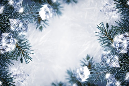 glistening: Winter backround with spruce branches and cubes of ice
