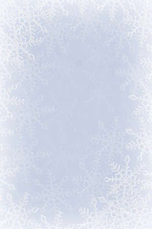 the frosty: Blue and white snowflakes on a blue and white background Stock Photo