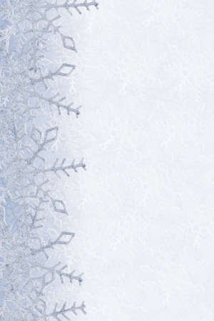 Blue and white snowflakes on a blue and white background photo