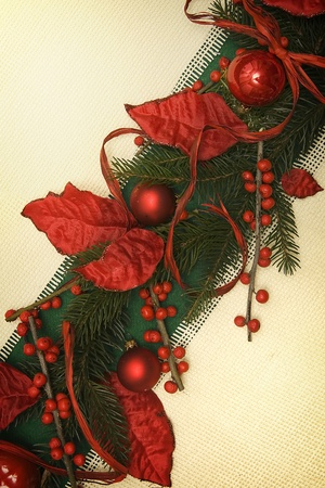 Christmas ornament made of green spruce and red adornment photo