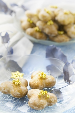 Glace little gignerbreads with golden sugar pearls photo