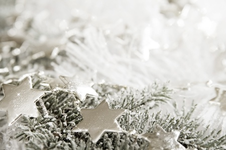 Silver sparkling stars on a white glistening background Stock Photo - 16945250
