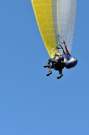 Tandem paragliders closeup with copy-space
