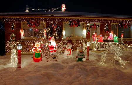 Christmas lights welcoming visitors in front of a house Stock Photo