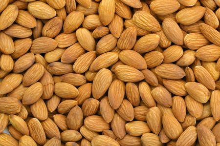 Top view of peeled almonds in natural light