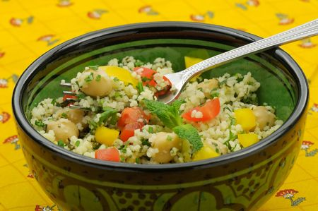 Close up of mediterranean couscous salad served in a Moroccan bowl