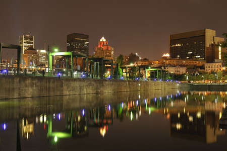 Old Port of Montreal by night with reflections