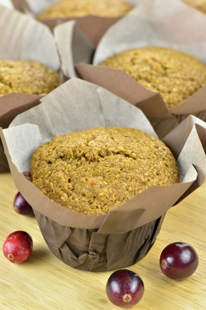 Close-up of freshly baked bran and cranberry muffins on a wooden tray Stock Photo - 17173352