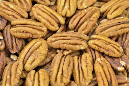 pecans: Pecan nut halves closeup