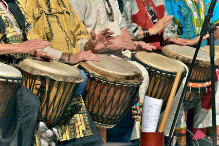 percussion: jembe player in group Stock Photo