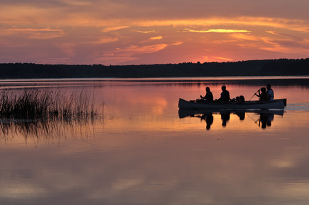 Two family bark Canoes at sunset Stock Photo