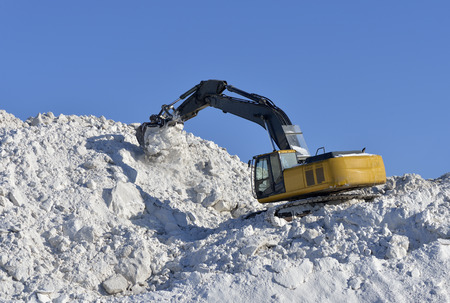 grader: Excavator stacked to store snow in winter