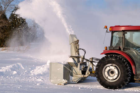 Tractor snowblower after a snowstorm photo
