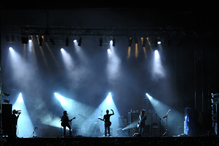 drummer: Rock concert live on stage outside silhouette of singers on stage