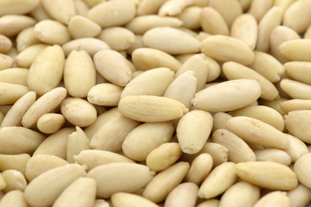 Close-up of shelled and blanched almonds kernel to use as background Stock Photo