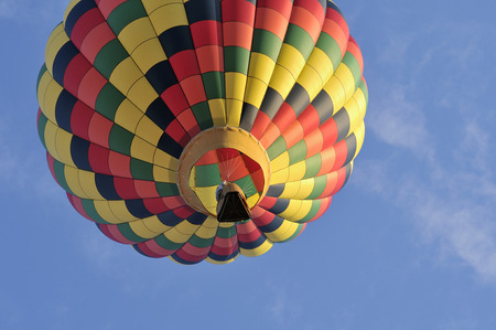A hot air balloon in the sky a sunny day