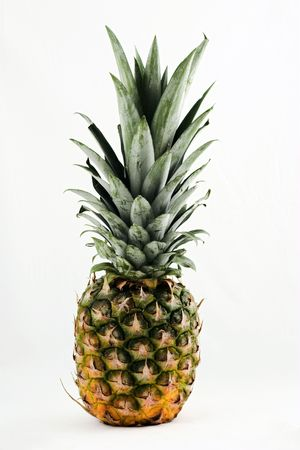 happens: The pineapple we buy tinned, but sometimes happens upon the table in the natural form Stock Photo