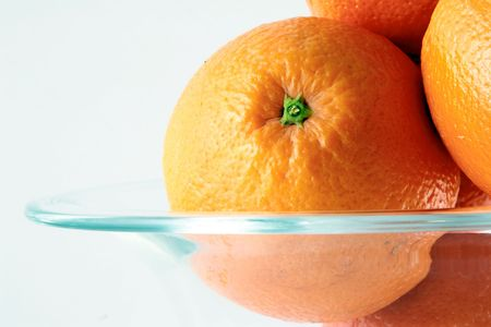 oranges in glass-dish on white background Stock Photo - 678984
