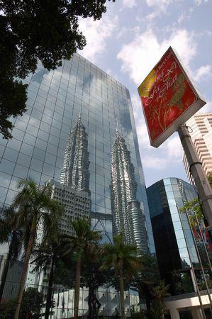 Reflection of Petronas Towers, Kuala Lumpur, Malaysia with Chinese New Year sign