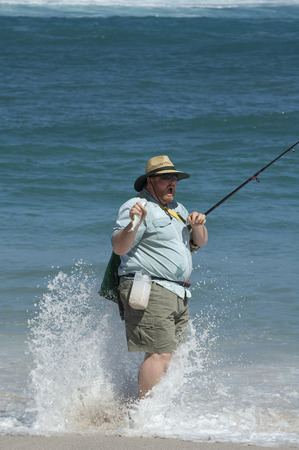 Fishing at Point Labat in South Australia and getting a cold wave up your pants Stock Photo - 1438108