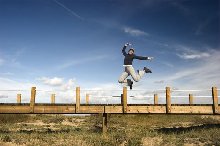 Young woman jumping for fun in a beautiful day Stock Photo - 791255