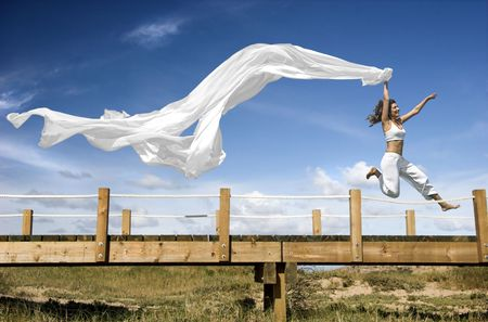 Young beautiful woman jumping with a scarf in a beautiful day Stock Photo - 791254