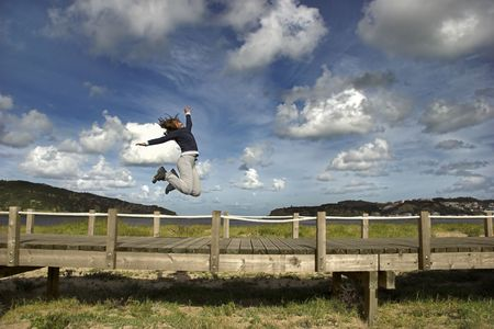 Young woman jumping for fun in a beautiful day Stock Photo - 791251