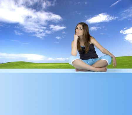 Beautiful Athletic woman seated and relaxing on a blue window photo