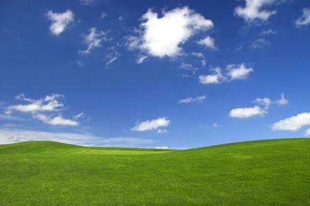 Beautiful green landscape with a great blue sky with white clouds   photo