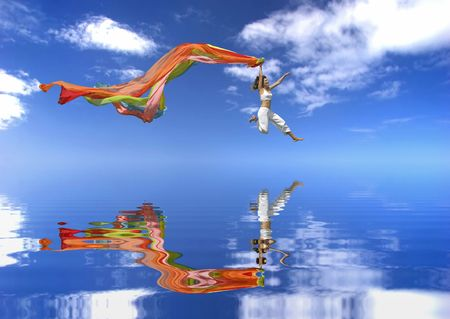 Beautiful woman jumping over the ocean with a colored scarf Stock Photo - 1092527